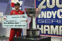 2006 IndyCar series champion Sam Hornish Jr. and the one million dollar check