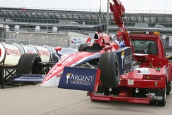 Buddy Rice's damged car returns to the garage area