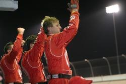 Ganassi Racing crew members cheer Scott Dixon on to victory