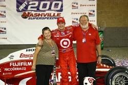 Victory lane: race winner Scott Dixon celebrates with his parents