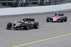 Eddie Cheever leads Buddy Rice down the back stretch
