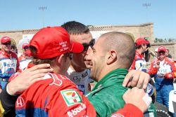 Andretti Green Racing teammates Dario Franchitti and Tony Kanaan welcome Marco Andretti to Victory l