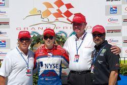 Firestone's Al Speyer with Mario, Marco and Michael Andretti