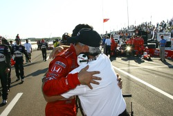 Race winner Helio Castroneves celebrates with Rick Mears
