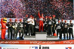 Podium: race winner Helio Castroneves celebrates with this team