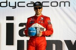 Podium: race winner Helio Castroneves celebrates