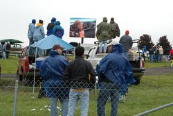Turn one crowd watches the big screen