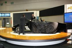 IMS President and COO Joie Chitwood, front, and Chevrolet GM Ed Peper begin to unveil the 30th anniv