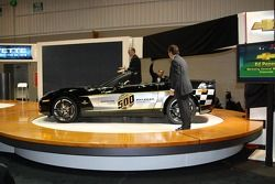 IMS President and COO Joie Chitwood, front, and Chevrolet GM Ed Peper finish unveiling the 30th anni