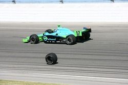 Ryan Hunter-Reay drives by the lost wheel of Tomas Scheckter