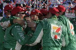 Victory lane: race winner Tony Kanaan celebrates with this team