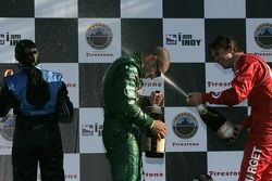 Podium: champagne for Tony Kanaan, Danica Patrick and Dan Wheldon