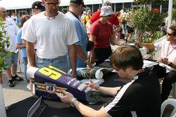 Buddy Lazier signs a nose cone