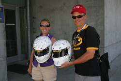 Fans show off their helmets with autographs