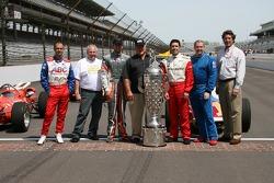 Darren Manning, George Snider, AJ Foyt IV, AJ Foyt, Larry Foyt, Al Unser Jr. and Tony George pose with the Borg-Warner Trophy on the yard of bricks