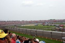 The crowd in corner four anticipates the start of the race