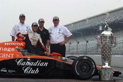 Kim Green, Dario Franchitti, Michael Andretti and Kim Savoree pose with the Borg Warner Trophy