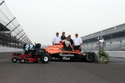 Dario Franchitti and the Toro lawnmower presented to the winner of the Indianapolis 500