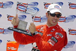 Helio Castroneves with the pole award