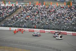 Crews clean up after Kosuke Matsuura crash on first lap