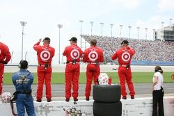 Chip Ganassi Racing crew members get ready to celebrate the victory of Scott Dixon