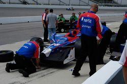 Andretti Green crewmen swarm over Marco Andretti's car