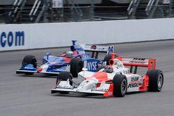 Marco Andretti goes around Helio Castroneves