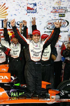 Winners circle: Dario Franchitti celebrates