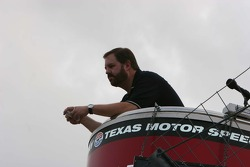 Eddie Gossage watches the pre-race activites from the flag stand