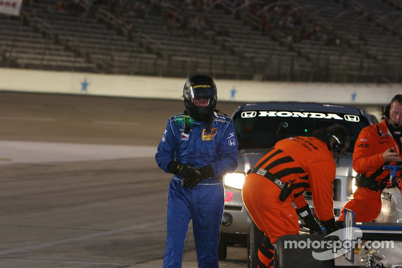 Jon Herb inspects his damaged car