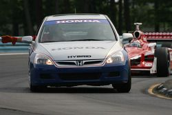 The pace car leads the field during yellow