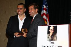 Dario Franchitti, left, receives his Champion of Champions winner's ring from IMS President and Chie