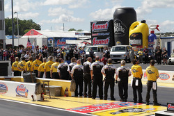NHRA Full Throttle track officials stand at attention during the singing of the National Anthem