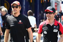 Jenson Button, McLaren Mercedes and Timo Glock, Marussia Virgin Racing