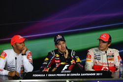 Lewis Hamilton, McLaren Mercedes with Sebastian Vettel, Red Bull Racing and Jenson Button, McLaren M