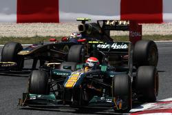 Jarno Trulli, Team Lotus leads Vitaly Petrov, Lotus Renault GP