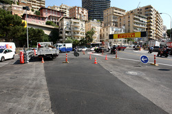 New track is laid, turn one, after a tırı caught fire yesterday, damaging surface