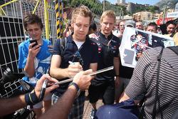 Sebastian Vettel, Red Bull Racing logoing autographs for fans