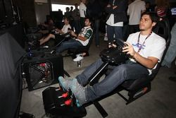 Fans try out an Indycar simulator