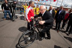 A bike is presented to Hans Werner Aufrecht, Team Chef HWA, ITR President for his 25 years of service at ITR