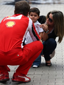 Rob Smedly, Scuderia Ferrari, Chief Engineer, Rafaela Bassi, Wife of Felipe Massa with son Felipinho