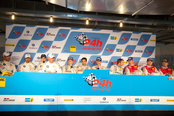 Post-race press conference: race winners Marc Lieb, Lucas Luhr, Romain Dumas, Timo Bernhard, second place Jorg Muller, Augusto Farfus Jr., Uwe Alzen, Pedro Lamy, third place Marc Basseng, Marcel Fässler, Frank Stippler