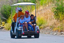 Kids really enjoying a ride on a gold cart