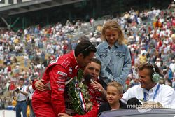 Helio Castroneves joins the party for Gil de Ferran's victory lap