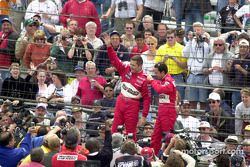 Gil de Ferran and Helio Castroneves wave to the cameras