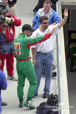Tony Kanaan and Michael Andretti wave to the crowd