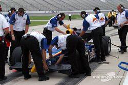 Crew work on Buddy Rice's car