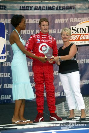 Scott Dixon is presented an award before the race