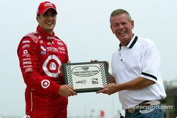 Tomas Scheckter receives the Bobby Unser Pole Award from Bobby Unser