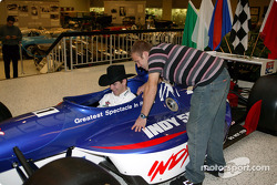 IndyCar Series driver Ed Carpenter shows pro bull rider Michael Gaffney the finer points of an IndyCar Series car